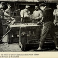 Six men, some amputees, in woodworking shop.