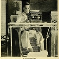 One-legged man sits at typewrite
