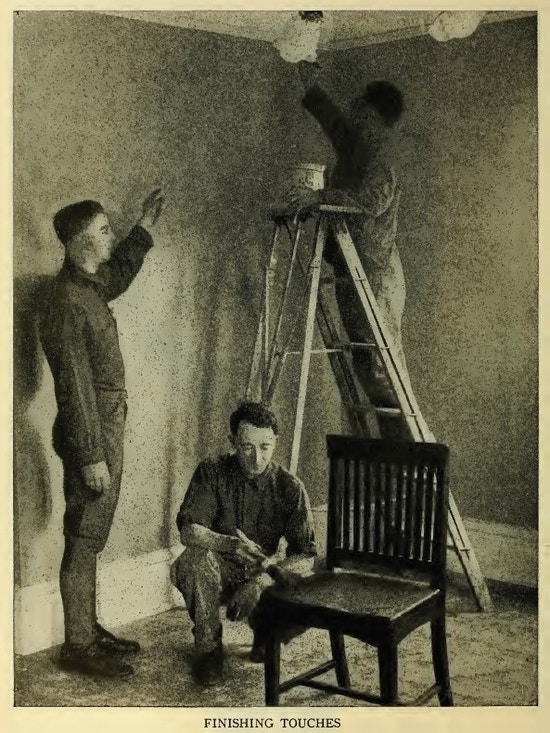 Three men housepainting.