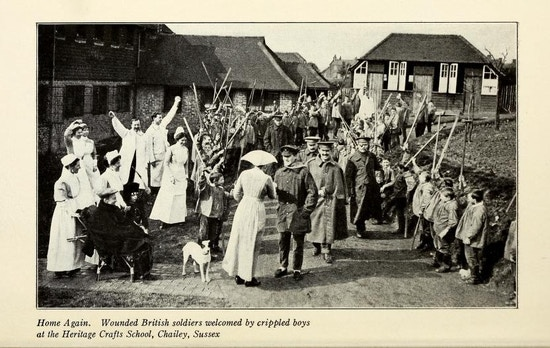 Soldiers march past disabled children and nurses in an English village.