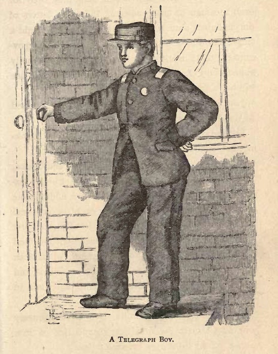 Boy in uniform stands next to door.