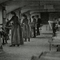 Young men and women in woodworking shop.