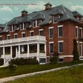 Postcard image of a three-story brick building.