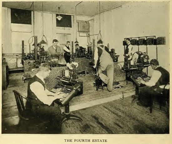 Six men working in a typesetting room.