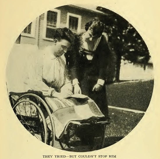 Man in wheelchair reading aletter, a woman standing net to him.