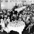 Large banquet room filled with men and women.