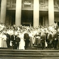 American Association To Promote Teaching Speech To The Deaf 1906 meeting group photograph taken on stairs with large columns in background.