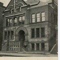 Photograph of a side with an arched entrance to the Horace Mann School, image of Sarah Fuller included at top.