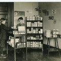 Wright Oral School students in a general store completing a transaction with one another.