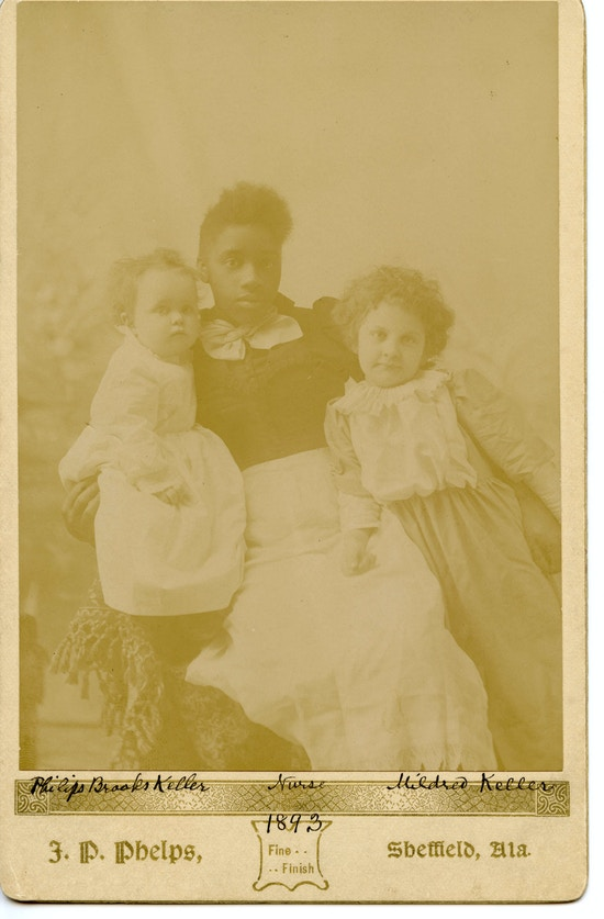 Nurse holding Mildred and Philips Brooks Keller in Tuscumbia, Alabama.