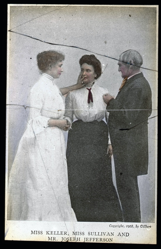 Helen Keller in lightly colored long dress, (left) Anne Sullivan in collard shirt and skirt, (center) and Jefferson in dark suit with goatee (right).