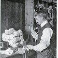 Man at a machine making dishmops
