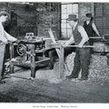 Three men working in a dowel shop.