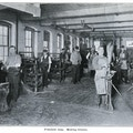 Seven men working in the Pittsfield Broom Making workshop.