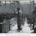 Two men working in wire drawing factory.