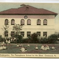 The Kindergarten, The Pennsylvania School for the Blind, Overbrook, Pennsylvania. A two-story building with tile roof, children in front.