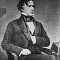 Franklin Pierce, seated, in suit, with hand inside vest.