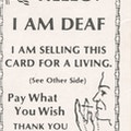 Card with American flag, text, and drawing of face and hand.