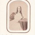 Miss Ella Brownell, portrait, at table, facing camera, with glasses.