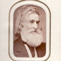 Samuel Gridley Howe, waist-up portrait, dark suit, gray hair and beard.