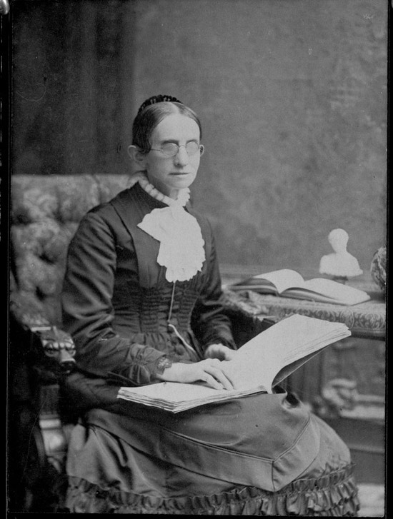 Bridgman, seated, book in lap