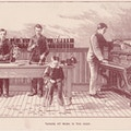 Four men and one boy in suits, in a piano tuning shop.