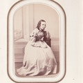 Miss Bertha Kerstow seated, face resting on hand.